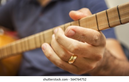 Closeup Shot Of A Man Playing Baglama (Turkish traditional stringed instrument) - Saz