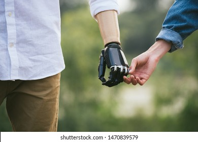 CloseUp Shot Of Man With a prosthetic limb Holding Hands With Female Partner, gentle touch, outdoor image