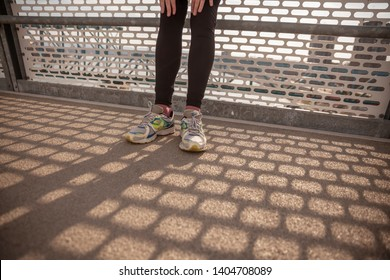 close-up shot of man running legs and running shoes.