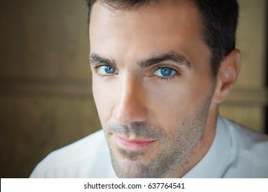 Close-up shot of man's eye. Man with blue eyes.