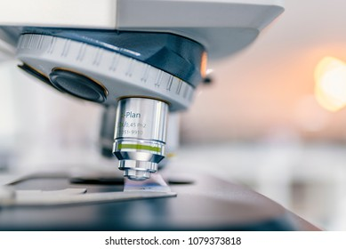 Close-up shot of microscope with metal lens at laboratory. Examining of test sample under the microscope in laboratory. Medical equipment. microscope. Background
