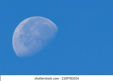 A close-up shot of the moon in the morning