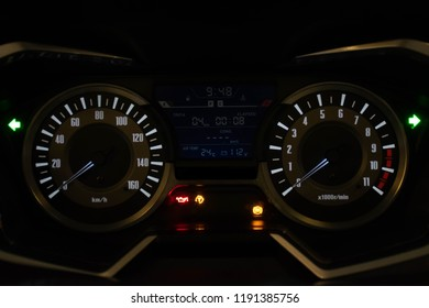 Closeup shot of an Motorcycle Auto odometer at night