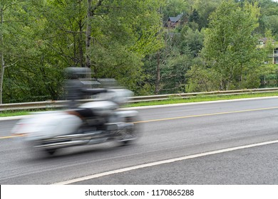 Closeup shot of a motorcycle in motion