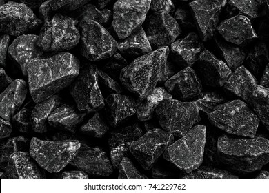 Closeup shot of natural black coals for background. Coal is the largest source of energy for the generation of electricity worldwide, Used as fuel for industrial coal.