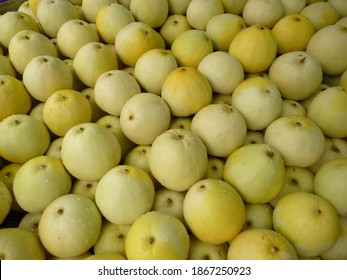 A closeup shot of neatly laid out apple mellons with droplets of water can be used as background