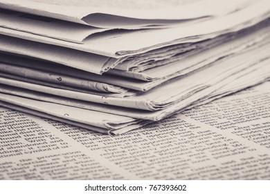 Close-up shot of newspaper on the desk.