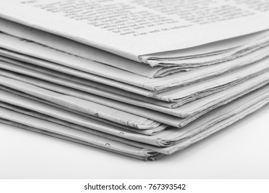 Close-up shot of newspaper on white background.