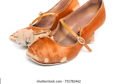 53b5404df closeup shot of pair of worn-out latin ballroom dance shoe - isolated
