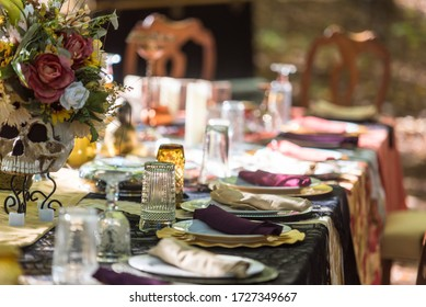 A closeup shot of the plates and silverware on a table decorated with flowers