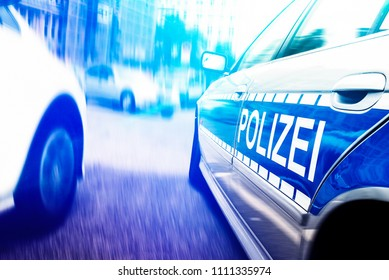 close-up shot of police car with flashing emergency lights on motion blurred urban street