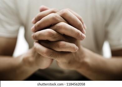 Closeup shot of praying hands.