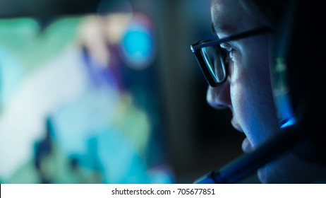 Close-up Shot of Professional Gamer Plays in MMORPG/ Strategy Video Game on His Computer. He's Participating in Online Cyber Games Tournament, Plays at Home, or in Internet Cafe.