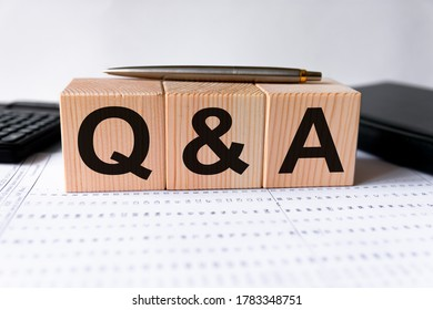 Close-up Shot of Q and A wooden blocks. Financial, marketing and business concepts