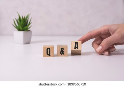 Close-up Shot of Q and A wooden blocks