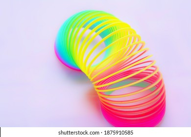 A closeup shot of rainbow slinky isolated on a white background