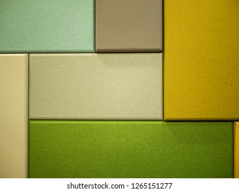 Close-up shot of Rectangle colored fabric boards in yellow and green tones