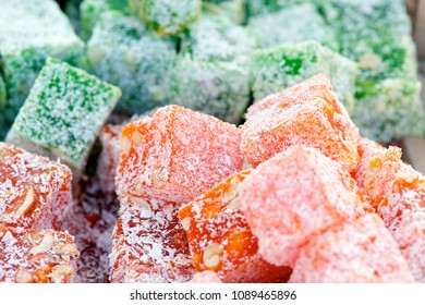 Closeup shot of red and green Turkish delight sweets (aka lokum or rahat lokum).