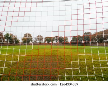 close-up shot of Red and white goal net of Rural soccer pitch in Germany