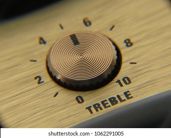 Close-up shot of a retro-style wireless speaker treble dial.