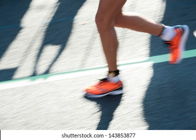 Close-Up shot of a runners feet while running. Longtime Exposure was used to visualize the motion