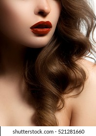 Closeup shot of sexy woman lips with bright red lipstick