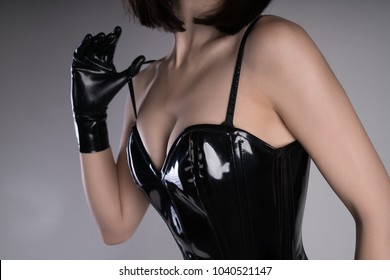 Close-up shot of a sexy woman wearing black gothic corset, studio shot