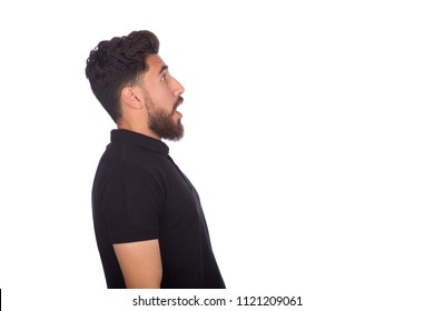 Close-up shot of shocked young man opens his mouth in a side shot, isolated on a white background.