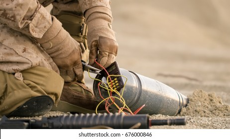 Close-up shot of Soldier Defusing a Bomb by Cutting a Wire During Military Operation in Desert Environment
