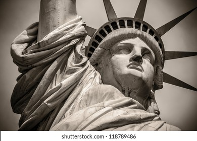 Close-up shot of the Statue of Liberty in black and white.