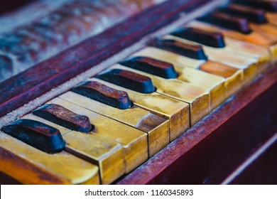 Close-up of  Shot of Traditional Old and Dusty Harmonium Keyboard.