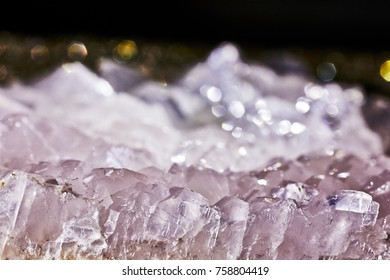 Closeup shot of translucent calcite with light effects in background