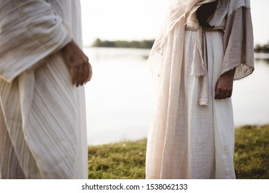 A closeup shot of two people wearing a biblical robe with a blurred background