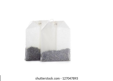 Close-up shot of two teabags on white background.