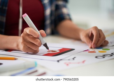 Close-up shot of unrecognizable manager sitting at office desk and preparing visual presentation for potential investors