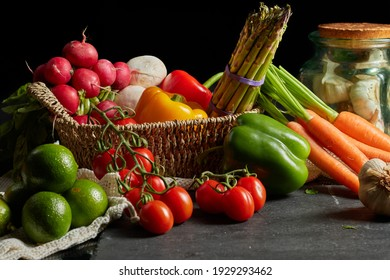 A closeup shot of vegetables in a basket  Colorful veggies including tomatoes, peppers and carrots