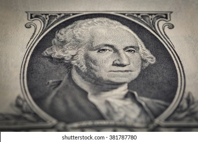 Close-up shot of washington portrait on the one dollar bill