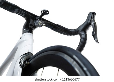 Closeup shot of a white roadbike with front flashlight under the handlebar