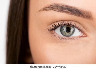 close-up shot of woman with beautiful eye looking at camera