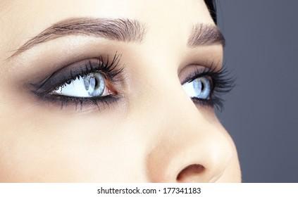 Closeup shot of woman eye with evening makeup