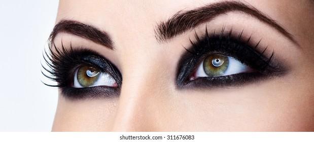 Closeup shot of woman eye with evening makeup. Long eyelashes. Smokey Eyes.