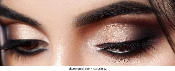 Closeup shot of woman eye with evening makeup. Long eyelashes. Smokey Eyes