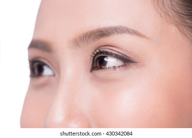Closeup shot of woman eyes with day makeup. Female eye with long eyelashes close up