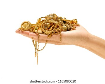 Close-up shot of woman holding lot of gold jewelry in her hand isolated on white background