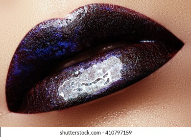 Close-up shot of woman lips with glossy plum lipstick. Perfect plum lips. Sexy girl mouth close up. Beauty young woman smile. Plump full Lips. Lips augmentation. Bright full lips