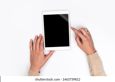Closeup shot of  Woman's hands with perfect manicure  holding tablet, Empty display device. with clipping path.White background