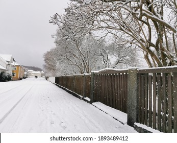 A closeup shot of a wooden fence in Larvik, Norway in winter