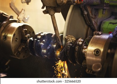 Closeup shot of working industrial machine. This machine is used for the treatment of automotive and marine and boat engines. Visible grain. Short depth of field and selective focus.