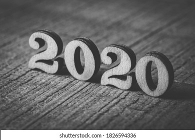 Closeup shot of Year 2020 wooden numbers on wooden background.