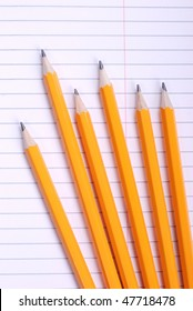 close-up shot of yellow pencils on notebook